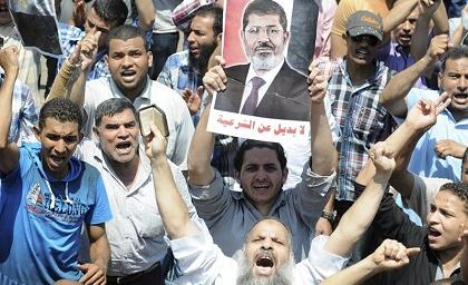 http://i.eldiario.com.ec/fotos-manabi-ecuador/2013/07/20130706101334_disturbios-en-egipto-dejan-al-menos_tn1.jpg