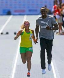 Usain Bolt corre como guía de la atleta ciega más rápida del mundo