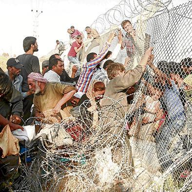 Estado Islámico impide el paso de miles de refugiados en frontera turco-siria