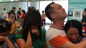 Una joven china se reencuentra con sus padres 13 años después de perderse