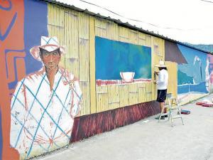 Pintan la identidad en un gran mural