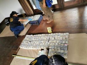 Fiscalía de Guatemala encuentra 15 millones de dólares en una vivienda
